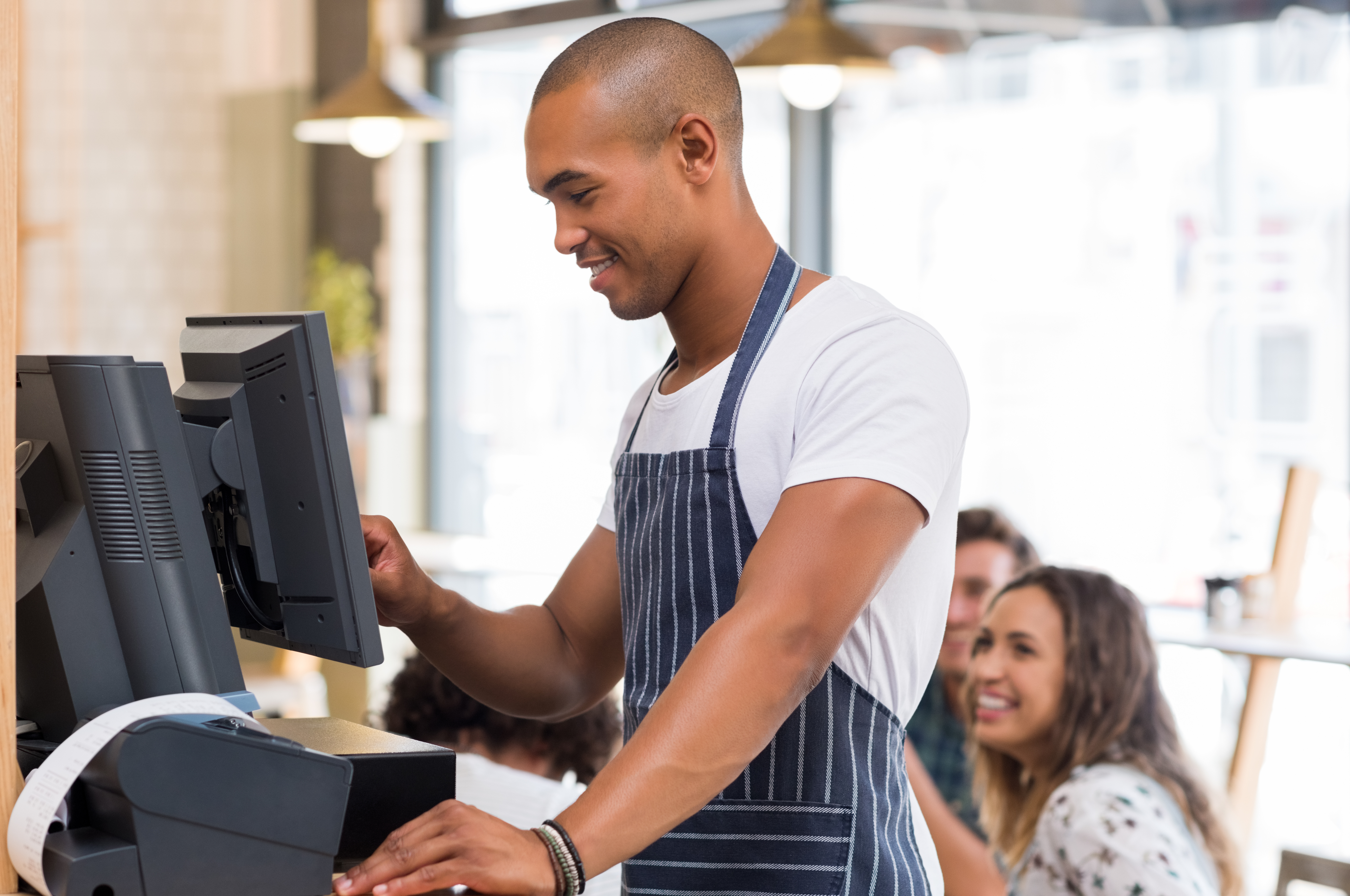 bigstock-Happy-young-waiter-in-blue-apr-147815501 (1)