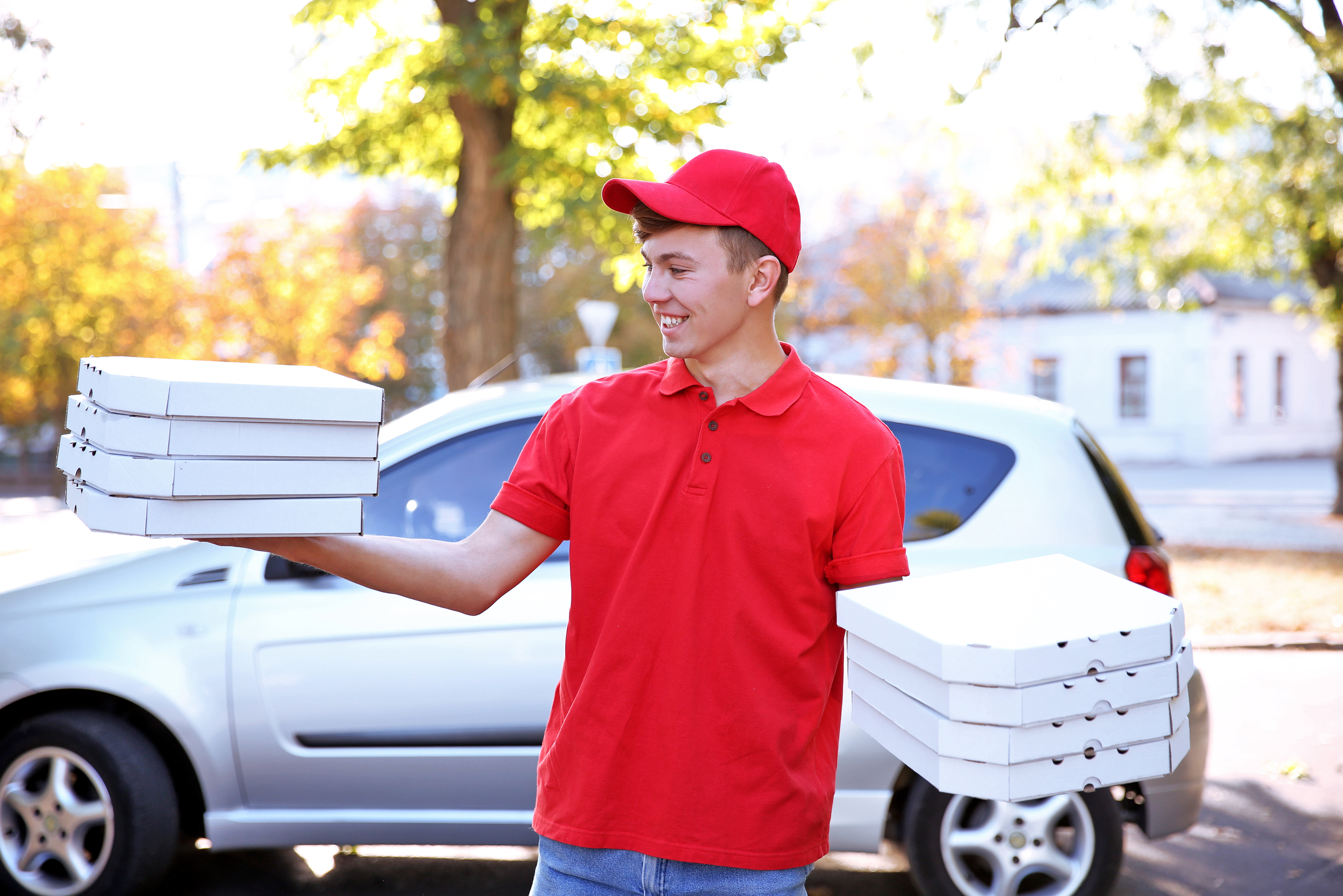 bigstock-Pizza-delivery-boy-holding-box-112695413